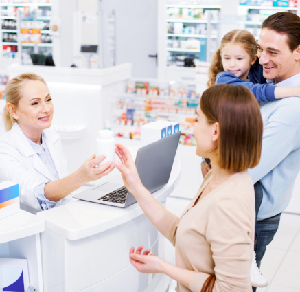 pharmacist and a family buying medicine