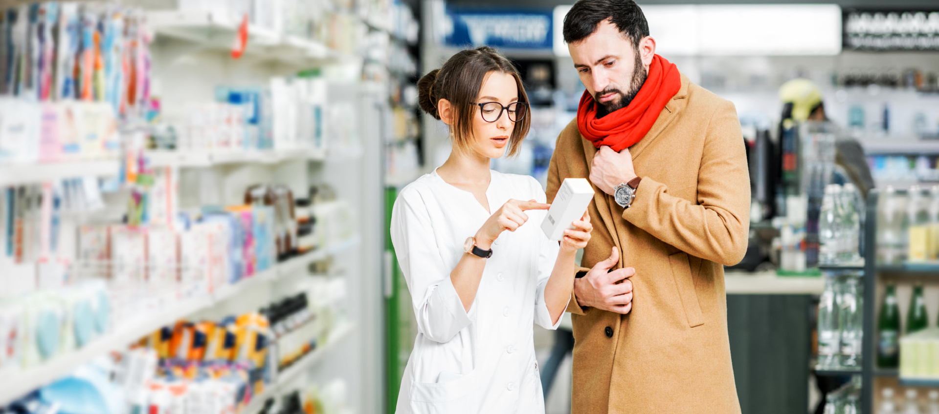 pharmacist and a customer looking for medicine